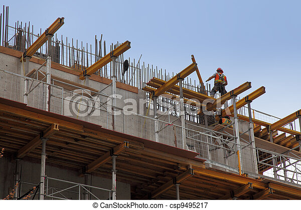 workers in action during construction of a steel beam office building - csp9495217