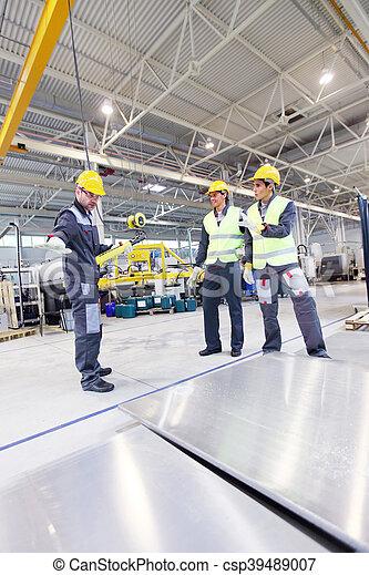 Workers near aluminium billets - csp39489007