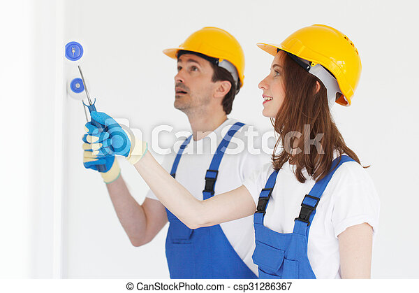 Workers painting wall - csp31286367
