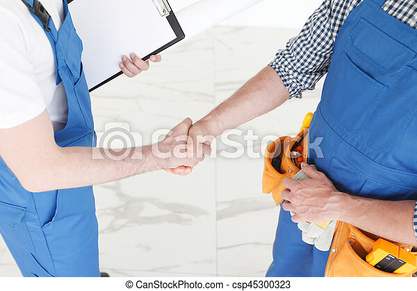 Workers shaking hands - csp45300323