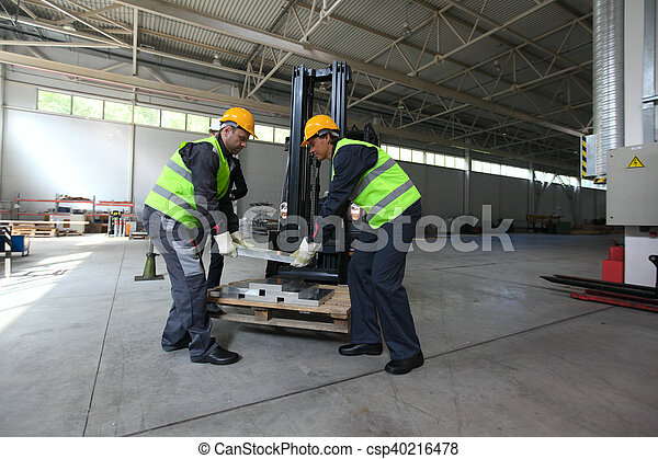 Workers taking aluminium billet - csp40216478
