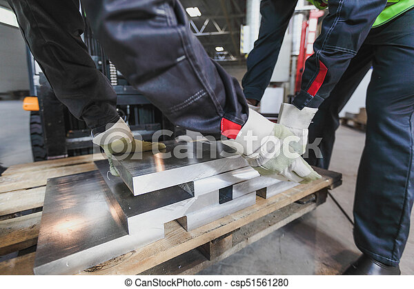 Workers taking aluminium billet - csp51561280