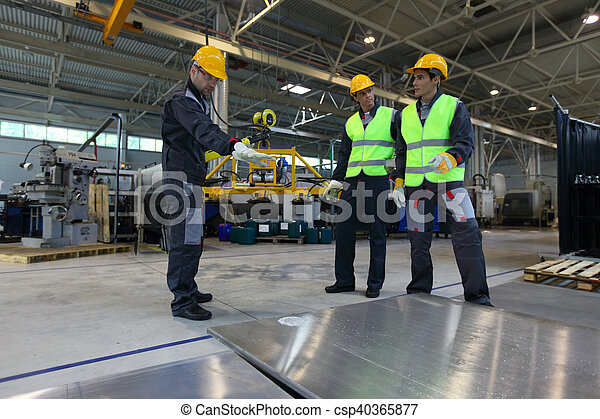 Workers working with aluminium billets - csp40365877