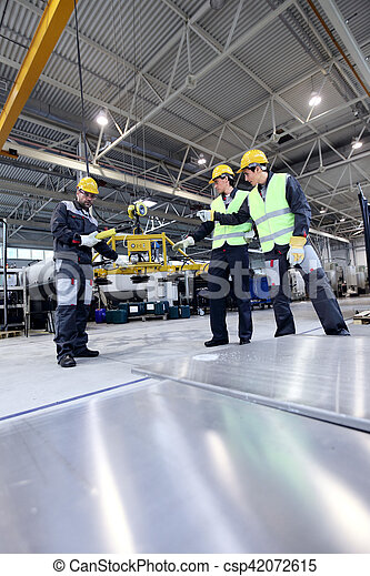 Workers working with aluminium billets - csp42072615