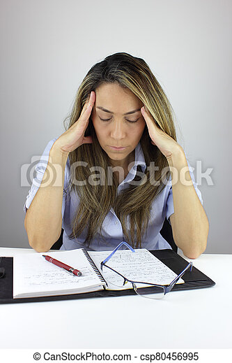 Working from home with a migraine - csp80456995