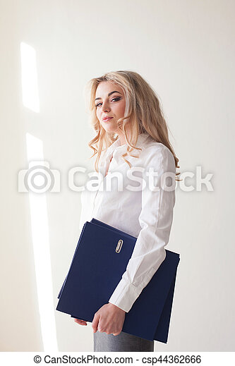 Working girl blonde with blue folders - csp44362666
