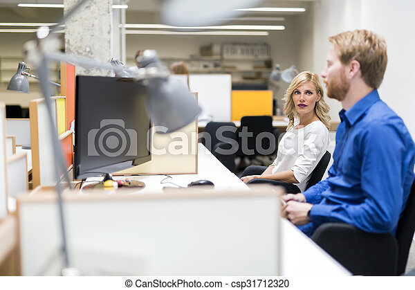 Working in an office - csp31712320