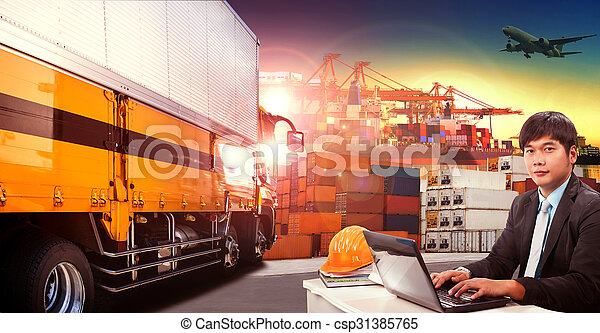 working man and container truck in shipping port ,container dock and freight cargo plane flying above use for transportation and logistic indutry - csp31385765