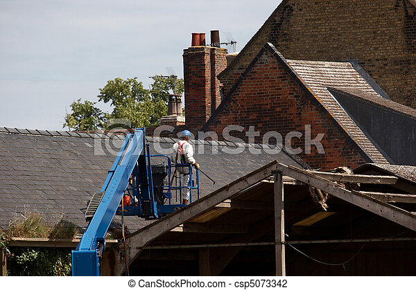 Workman removing roof - csp5073342