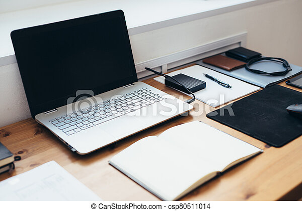 Workplace in office space. Work desk accessories - csp80511014