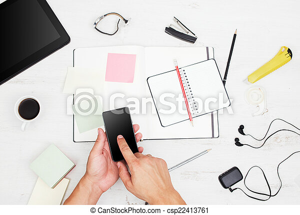 Workplace. Top view. Man working with modern devices and writing - csp22413761
