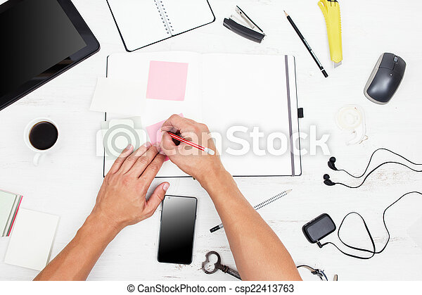 Workplace. Top view. Man working with modern devices and writing - csp22413763