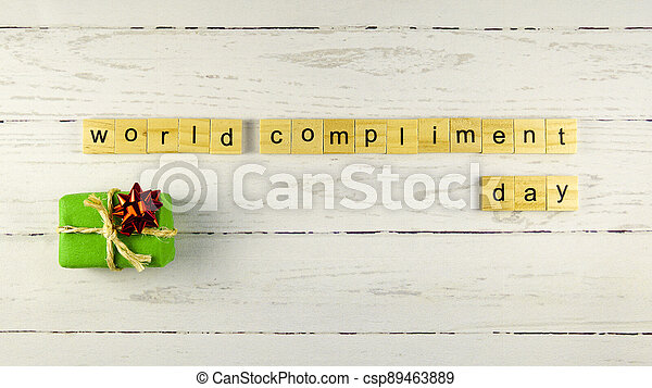 World Compliment Day.words from wooden cubes with letters - csp89463889