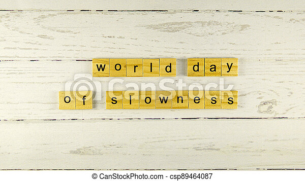 world day of slowness.words from wooden cubes with letters - csp89464087