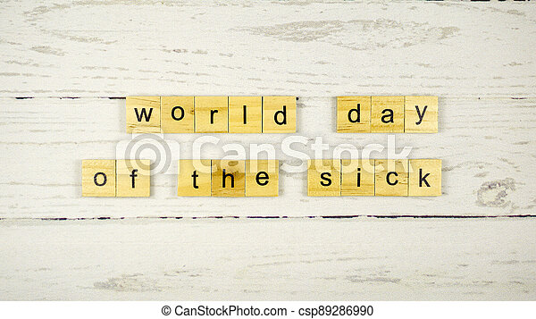 World Day of the Sick.words from wooden cubes with letters - csp89286990