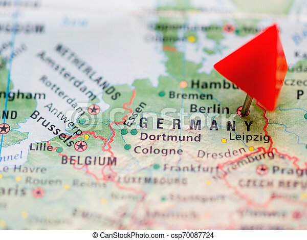 World map with focus on Federal Republic of Germany with red triangle pin  on capital city Berlin.