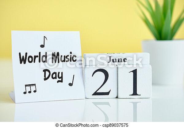 World Music Day 21 twenty first june Month Calendar Concept on Wooden Blocks. - csp89037575