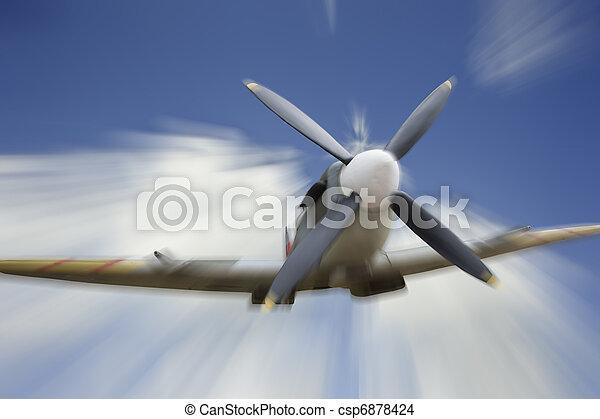 World War 2 era British aircraft Spitfire in flight - csp6878424