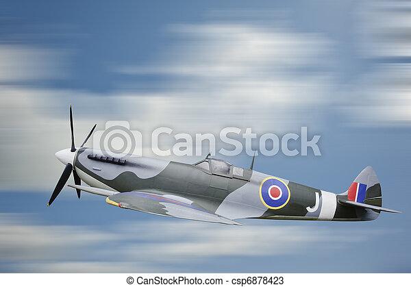 World War 2 era British aircraft Spitfire in flight - csp6878423