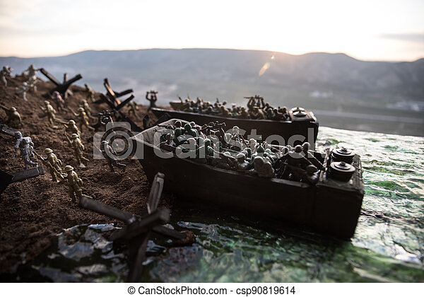 World War 2 reenactment (D-day). Creative decoration with toy soldiers, landing crafts and hedgehogs. Battle scene of Normandy landing on June 6, 1944. - csp90819614