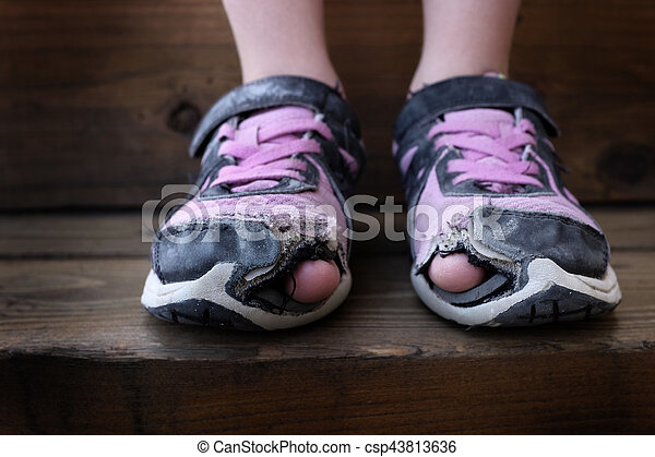 worn out old shoes with holes in toes homeless child worn out old