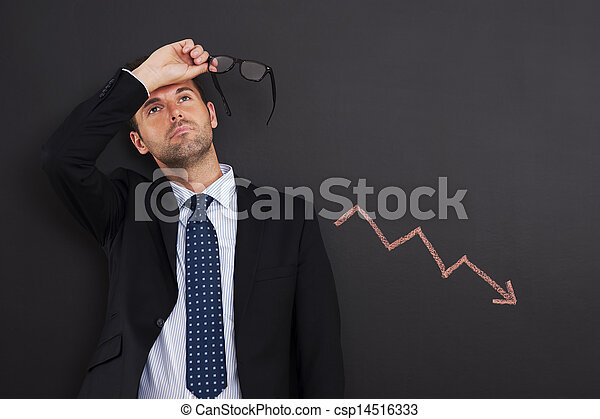 Worried businessman with sign of decreased profit - csp14516333