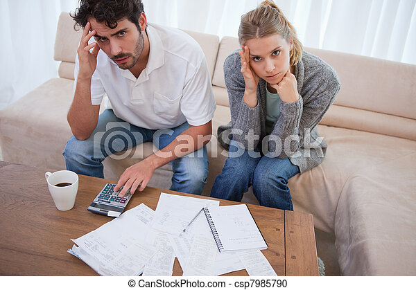 Worried couple doing their accounting - csp7985790
