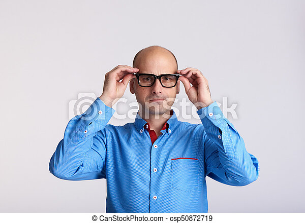 worried man wearing eyeglasses isolated - csp50872719