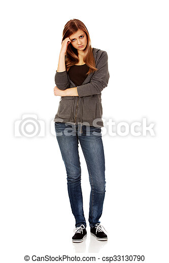 Worried teenage woman with folded arms - csp33130790