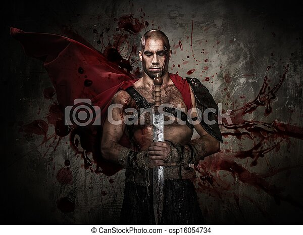 Wounded gladiator holding sword covered in blood with both hands - csp16054734