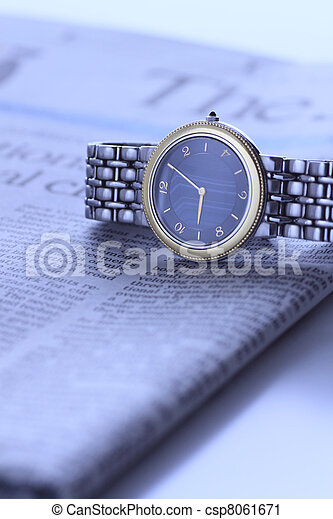 wrist  watch over newspaper - csp8061671