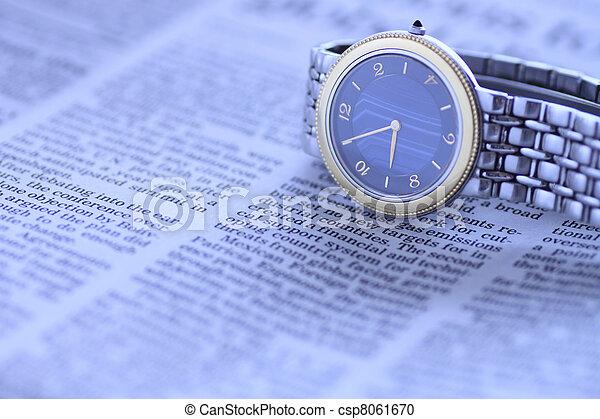 wrist  watch over newspaper - csp8061670