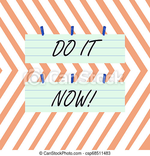 Writing note showing Do It Now. Business photo showcasing not hesitate and start working or doing stuff right away Strip Size Lined Paper Sheet Hanging Using Blue Clothespin. - csp68511483