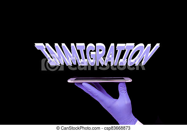 Writing note showing Immigration. Business photo showcasing the action of coming to live permanently in a foreign country Displaying Sticker Paper Accessories With Medical Gloves On. - csp83668873