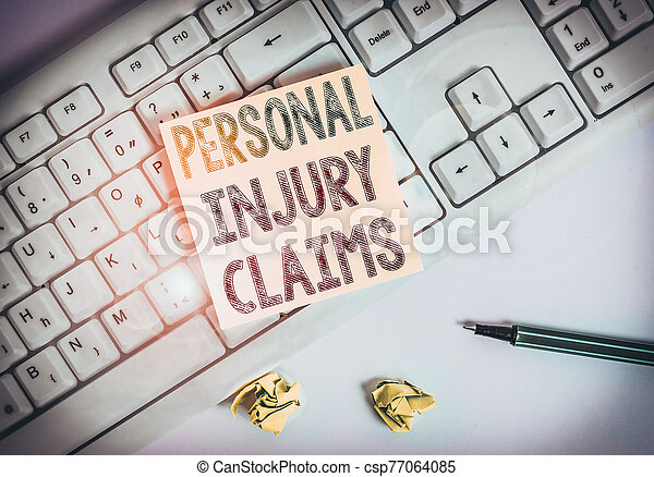 Writing note showing Personal Injury Claims. Business photo showcasing being hurt or injured inside work environment Green note paper with pencil on white background and pc keyboard. - csp77064085