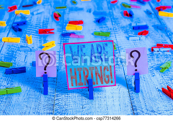 Writing note showing We Are Hiring. Business photo showcasing recently you employ someone or pay someone to do particular job Crumbling sheet with paper clips placed on the wooden table. - csp77314266