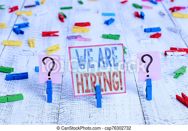 Writing note showing We Are Hiring. Business photo showcasing recently you employ someone or pay someone to do particular job Crumbling sheet with paper clips placed on the wooden table. - csp76302732