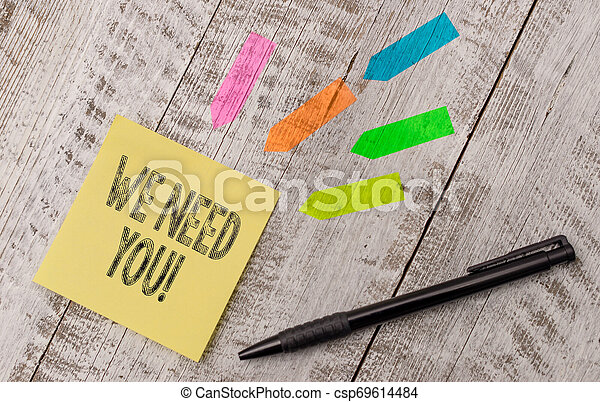 Writing note showing We Need You. Business photo showcasing asking someone to work together for certain job or target Note paper and line arrow stickers on the top of wooden table desk. - csp69614484