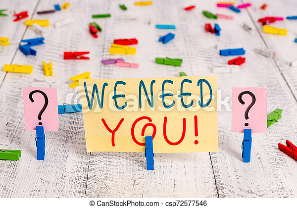 Writing note showing We Need You. Business photo showcasing asking someone to work together for certain job or target Crumbling sheet with paper clips placed on the wooden table. - csp72577546