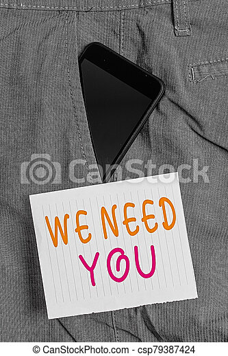 Writing note showing We Need You. Business photo showcasing asking someone to work together for certain job or target Smartphone device inside trousers front pocket note paper. - csp79387424