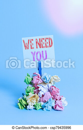 Writing note showing We Need You. Business photo showcasing asking someone to work together for certain job or target Reminder pile colored crumpled paper clothespin wooden space. - csp79435996