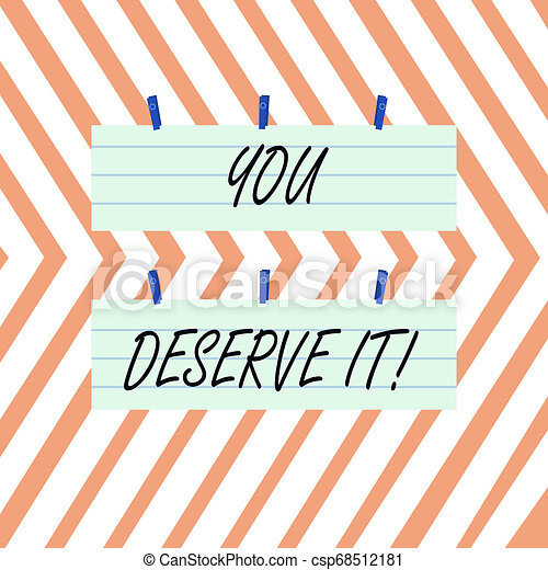 Writing note showing You Deserve It. Business photo showcasing should have it because of their qualities or actions Strip Size Lined Paper Sheet Hanging Using Blue Clothespin. - csp68512181