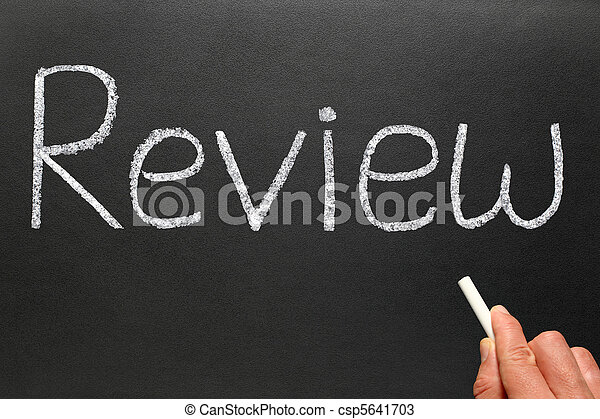Writing review with white chalk on a blackboard. - csp5641703