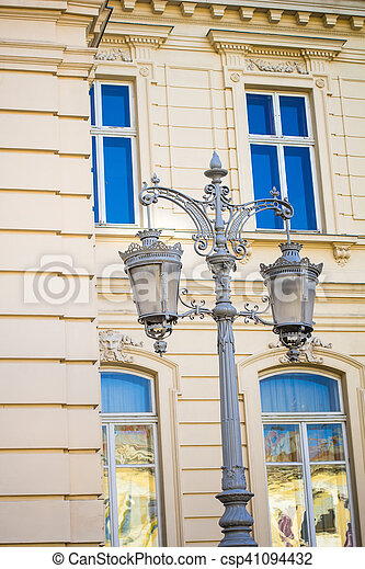 Wrought iron lanterns on a background window - csp41094432