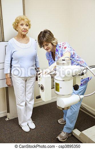 X-ray Tech Sets Up Machine - csp3895350