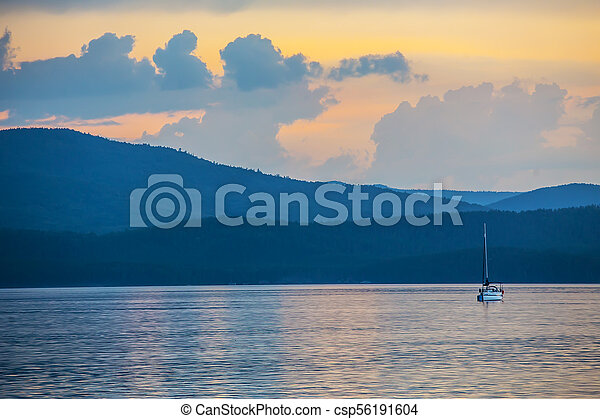 yacht on the lake in the evening - csp56191604