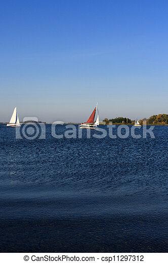 Yacht sailing on lake - csp11297312