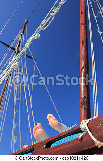 yacht's hinge with sail rolled-up - csp10211426
