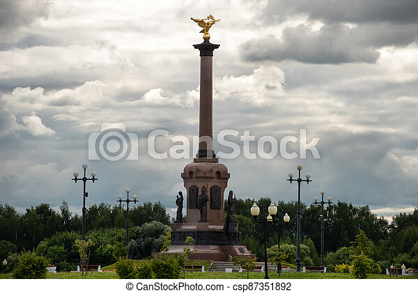 Yaroslavl, Russia - August 14, 2020: View on a cloudy summer day at the monument to the Millennium of Yaroslavl, located in Strelka Park, at the confluence of the Volga and Kotorosl rivers. Yaroslavl is part of the Golden Ring of Russia. - csp87351892