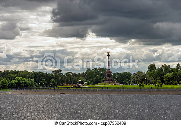 Yaroslavl, Russia - August 14, 2020: View on a cloudy summer day at the monument to the Millennium of Yaroslavl, located in Strelka Park, at the confluence of the Volga and Kotorosl rivers. Yaroslavl is part of the Golden Ring of Russia. - csp87352409